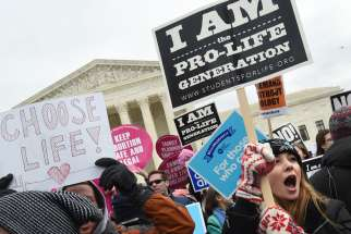 Pro-life advocates gather outside the U.S. Supreme Court Jan. 27, 2017, during the annual March for Life in Washington. According to a report released Sept. 18, 2019, by the Guttmacher Institute, which researches data on abortion, the number and rate of abortions nationwide have fallen to their lowest levels since the Supreme Court's Roe v. Wade decision legalized abortion on demand in 1973. The report is based on data from 2017, the last year for which full numbers were available.