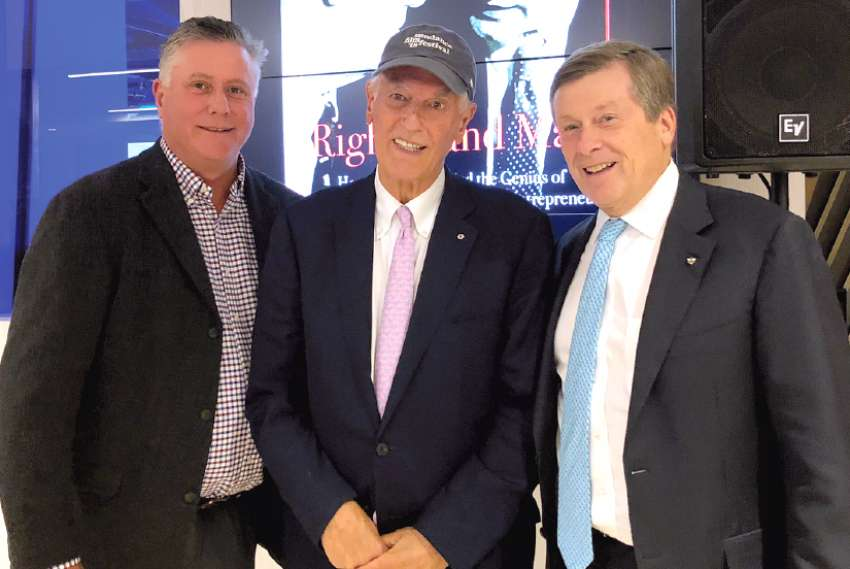 Phil Lind, centre, poses with Robert Brehl, left, and Toronto Mayor John Tory at the launch for Right Hand Man. Along with his political career, Tory was an executive at Rogers Communications.