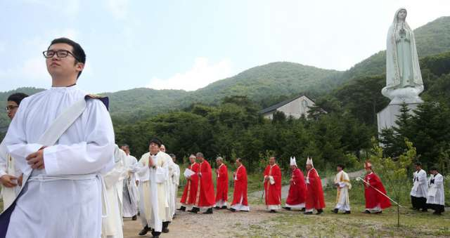 A Catholic ceremony takes place at the historic Chon Jin Am site in Gwangju, South Korea, June 24. The country is set to host about 30 countries for a five-day Asian Youth Day event that is focused on formation and spiritual life, particularly for youth leaders. The event will coincide with Pope Francis' visit to that country, where he is scheduled to beatify 124 Korean martyrs.