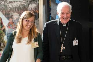 Italian synod observer Federica Ancona is pictured with Cardinal Marc Ouellet, prefect of the Congregation for Bishops, at the Synod of Bishops on young people, the faith and vocational discernment at the Vatican Oct. 19.
