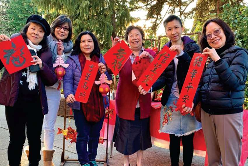 Members of Our Lady of Fatima Parish in Coquitlam, B.C., hold their creations for the Lunar New Year celebration, held Feb. 5.