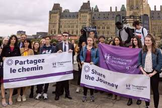 Students and teachers made their voices known to politicians when they went to Ottawa in May to present postcards asking the government to address the causes of the global migration crisis.