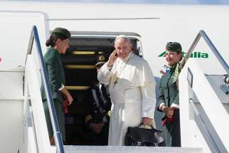 Pope Francis boards the plane in Italy for his trip to Colombia Sept. 6.