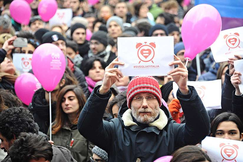 People gather to demonstrate in favor of the law on civil unions in Florence, Italy, Jan. 23. After months of public debate and protests, the Italian Senate passed a bill that grants legal recognition to nonmarried heterosexual and homosexual couples.