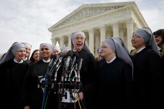 Sister Loraine Marie Maguire, mother provincial of the Denver-based Little Sisters of the Poor, speaks to the media outside the U.S. Supreme Court in Washington March 23 after attending oral arguments in the Zubik v. Burwell contraceptive mandate case.