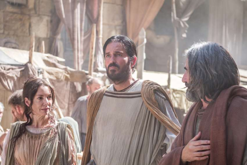 Jim Caviezel, centre, prepared to play Luke through and receiving the Eucharist.