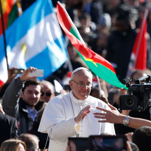 Pope Francis greets the crowd in St. Peter's Square before celebrating his inaugural Mass at the Vatican March 19.