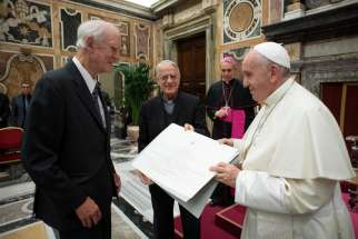 Pope Francis presents the Ratzinger prize to philosopher Charles Taylor during a ceremony at the Vatican Nov. 9, 2019. Taylor and Jesuit Father Paul Bere were chosen as prize winners by the Joseph Ratzinger-Benedict XVI Foundation.