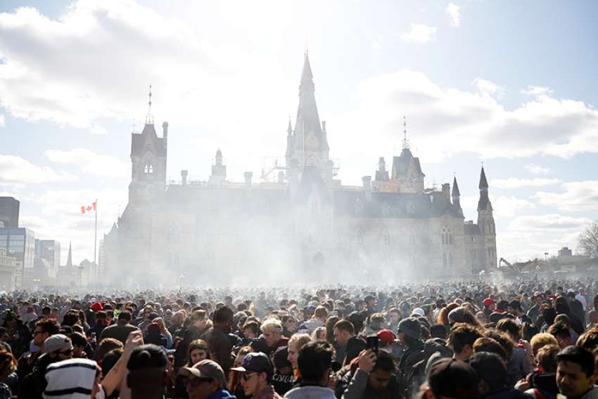 Smoke rises during the annual marijuana rally on Parliament Hill in Ottawa, Ontario, April 20. Msgr. Frank Leo, general secretary of the Canadian Conference of Catholic Bishops, says with the exception of cannabis use for medicinal purposes, consuming marijuana violates the virtue of temperance and should be avoided.