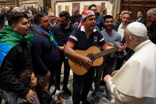 Pope Francis listens to men sing during a meeting with Italy's Roma, Sinti and Gypsy communities at the Vatican May 9, 2019.