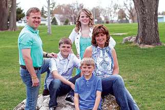 Todd Burpo, left, next to Colton, and the rest of the Burpo family.