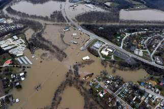 Submerged roads and houses are seen Dec. 28 after several days of heavy rain led to flooding in Union, Mo. Pope Francis called on Christians to pray for victims of several natural disasters that have hit parts of the United States, Great Britain and Paraguay.