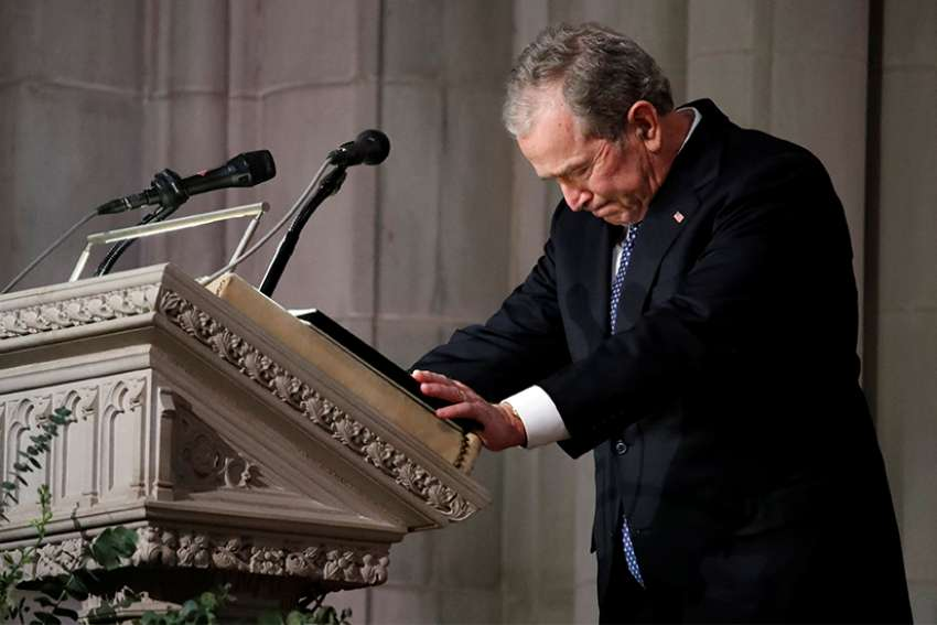 Former U.S. President George W. Bush pauses as he speaks at the state funeral for his father, former President George H.W. Bush, Dec. 5 at the Episcopal Church's Washington National Cathedral.