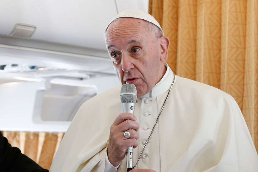 Pope Francis stands next to Jesuit Father Federico Lombardi, Vatican spokesman, as he speaks to journalists aboard his flight from Rome to Krakow, Poland, July 27. The Pope sends a video message specifically to those who couldn't afford to attend World Youth Day back in Havana, Cuba, July 29.