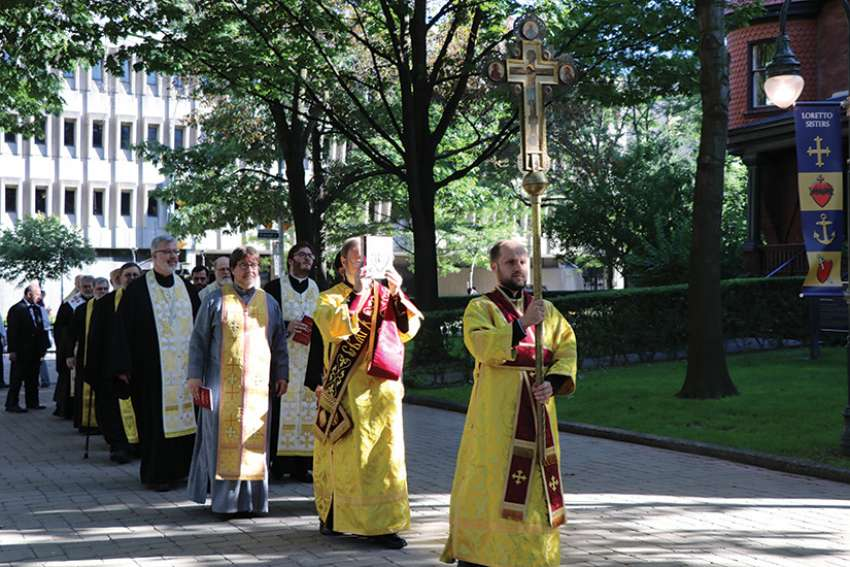 A procession begins the July 25 welcoming ceremony at the University of St. Michael's College for the Sheptytsky Institute of Eastern Christian Studies.