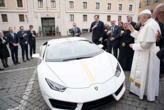 Pope Francis blesses his new Lamborghini Huracan in the presence of top executives from the luxury Italian sports car brand on Nov. 15 at the St. Martha guest house.