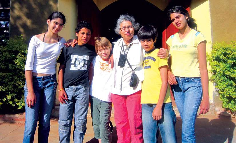 Rosa Frias, third from right, poses with young people, in Limpio, Paraguay, where her charity Children of Paraguay recently opened a children's medical clinic. The Ottawa woman was inspired to continue her work after an audience with Pope Francis.