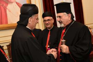Lebanese Cardinal Bechara Rai, patriarch of the Maronite Catholic Church, and Syriac Catholic Patriarch Ignace Joseph III Younan share Christmas greetings Dec. 24, 2018, in Bkerke, Lebanon. To support the faithful and encourage them to stay in their homeland, the Syriac Catholic Church has reestablished a diocese for the Kurdistan region of Iraq.