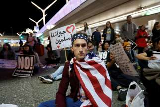 Demonstrators at LAX International Airport in Los Angeles protest the travel ban imposed by President Donald Trump Jan. 29.