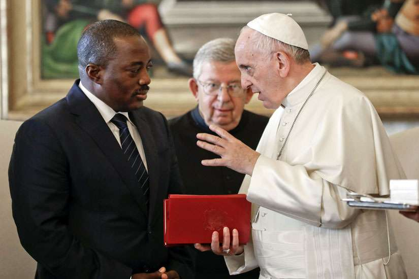 Pope Francis talks with Congolese President Joseph Kabila during a private audience at the Vatican Sept. 26. The Catholic church has pulled out of a national dialogue in Congo, after its president backed the postponement of elections a week after meeting the Pope.
