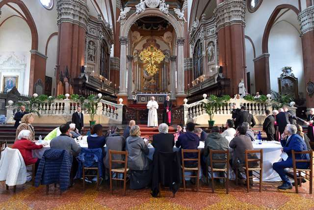 Pope Francis speaks during lunch with the poor, refugees and detainees in the Basilica of San Petronio in Bologna, Italy, Oct. 1.