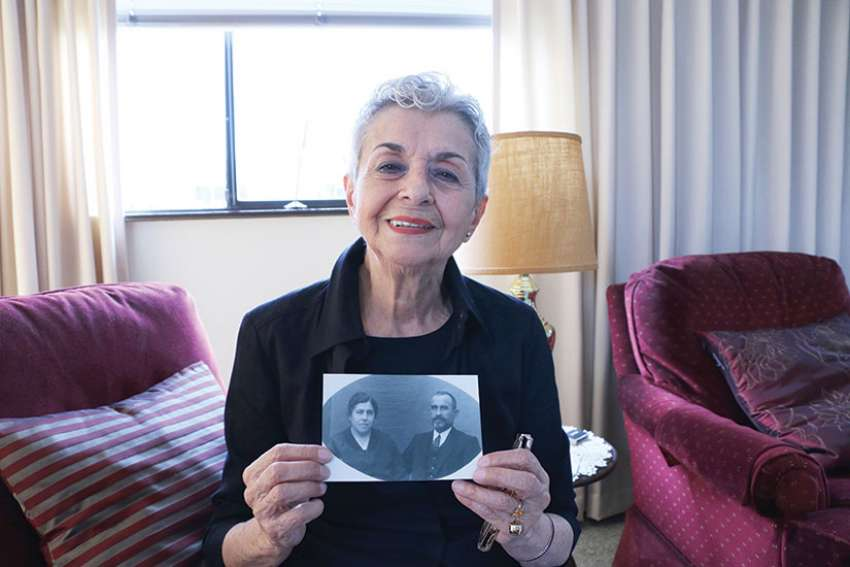 Nina Pickburn with a photo of her grandparents, who helped Fr. Gines Cespedes Gerez, a Spanish priest who was later killed during the Spanish Civil War.