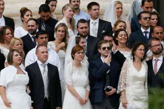 Couples with kids, cohabitating are among those marrying at papal Mass