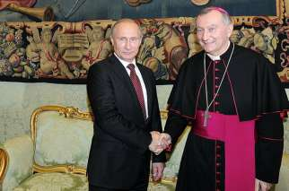 Cardinal Pietro Parolin greets Russian President Vladimir Putin at the Vatican in 2013. Cardinal Parolin will be visiting Russia later in August.