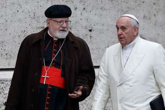 Pope Francis talks with Cardinal Sean P. O'Malley of Boston, whom the Pope re-appointed to be president of the commission, which the Pope originally established in 2014.