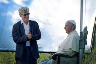 "German filmmaker Wim Wenders is pictured in this undated photo with Pope Francis during the production of his documentary film, ""Pope Francis -- A Man of His Word."" The film was compiled from four long sit-down sessions with the pope and from clips of the pope at the Vatican and abroad. It is scheduled for release in theaters May 18."