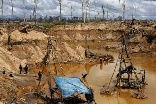 Peruvian police take part in an operation to destroy illegal gold mining camps in 2015 in a zone known as Mega 14, in the southern Amazon region of Madre de Dios, Peru.
