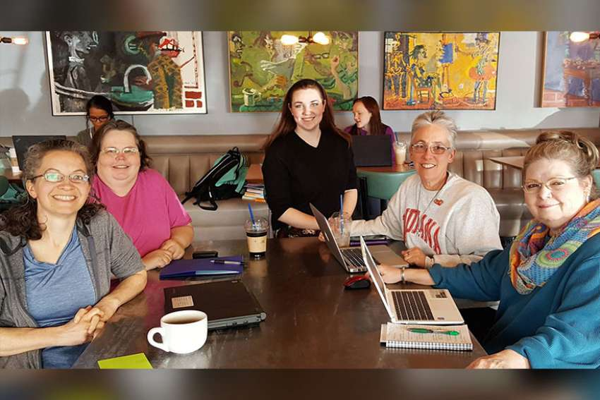 Sister Barbara Battista, a member of the Sisters of Providence of Saint Mary-of-the-Woods, Ind., second from right, participates in a planning meeting for the Wabash Valley March for Science in Terre Haute, Ind.