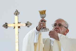 Pope Francis celebrates Mass May 27 during his pastoral visit in Genoa, Italy.