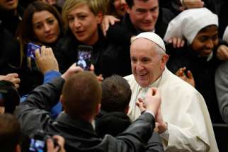 Pope Francis greets people as he leaves his general audience in Paul VI hall at the Vatican Jan. 13.