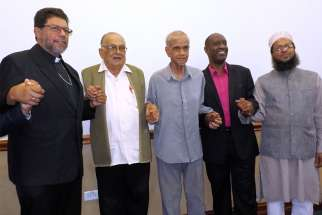 Port of Spain Archbishop Jason Gordon poses for a photo with other faith leaders June 11. Also pictured are Hindu Satnarayan Maharaj, Imam Yacoob Ali, evangelical Desmond Austin and Mufti Mohammed Haque.