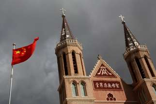 The Chinese national flag is pictured in a file photo in front of a Catholic church in the village of Huangtugang.