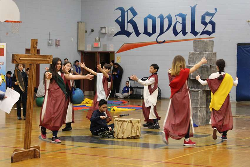 Elementary students dress up and perform a traditional Inuit dance during the liturgy at the Northern Spirit Games at Toronto's Bishop Marrocco Catholic High School.