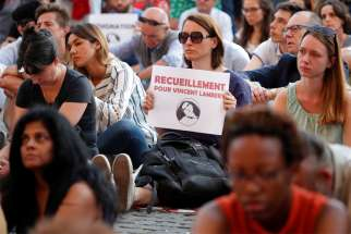 "People demonstrate in Paris July 10, 2019, in support of Vincent Lambert, who suffered serious brain damage and had been in a deep vegetative state for more than a decade. ""Every life is valuable, always,"" Pope Francis tweeted after offering prayers for Lambert, a 42-year-old French man who died July 11, nine days after doctors stopped providing him with nutrition and hydration."