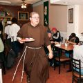 Br. Ken Cole, 49, is originally from Kitchener, Ont. He has been with the Capuchin Franciscans for five years and will take final, solemn vows next year. A former salesman, he came to realize he was meant for a life of service. Here he serves a meal at St. Francis' Table in Toronto's Parkdale area.