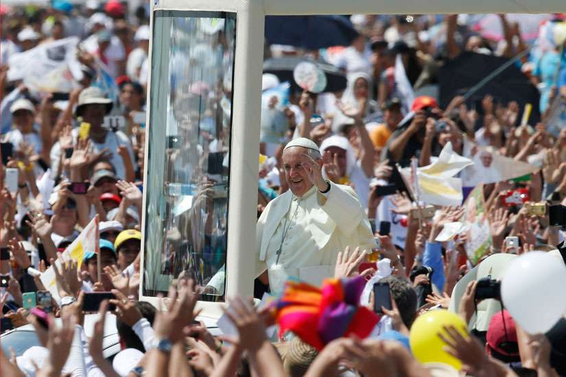 Pope Francis greets the crowd as he arrives to celebrate Mass in Los Samanes Park in Guayaquil, Ecuador, July 6.
