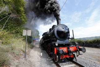 A historic train arrives in Castel Gandolfo, Italy, after leaving from the Vatican rail station during a special tour for journalists Sept. 11. The Vatican Museums and the Italian railway have partnered to offer train tours from the Vatican to Castel Gandolfo, site of the traditional papal summer villa.