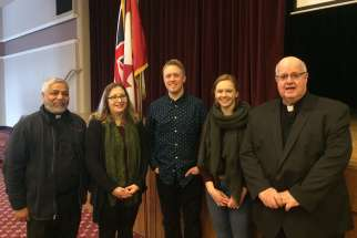 Catholic participants in the Celebrating Our Diversity Now event in February included, from left,  Fr. Prakash Lohale, Monica Marcelli-Chu, Leslie Gyulay, Catherine Morley and Fr. Tim MacDonald.