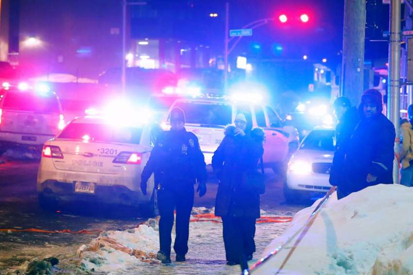 Police officers are seen near a mosque after a shooting in Quebec Jan. 29.