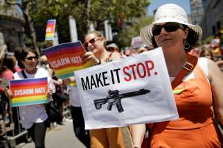 A woman holds a sign advocating for gun control while marching with Moms Demand Action at the gay pride parade in San Francisco June 26. In the first 180 days of 2016, there have been 163 mass shootings in the United States, according to data gathered by the Washington-based nonprofit Gun Violence Archive.