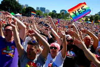 "Supporters of the ""Yes"" vote for marriage equality celebrate Nov. 15 in Sydney. After a majority of Australians indicated they favored same-sex marriage, Australia's bishops said legislators must ensure that any new law on marriage include protection for religious freedom."