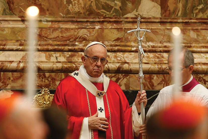 Pope Francis celebrates a Mass in memory of cardinals and bishops who died in the past year, in St. Peter's Basilica at the Vatican Nov. 3.