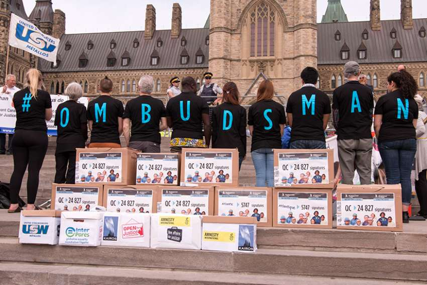 Development and Peace rallied for mining accountability in Ottawa May 2014. Boxes were filled with over 80,000 postcards addressed to Canadian MPs to call for support for a mining ombudsperson.