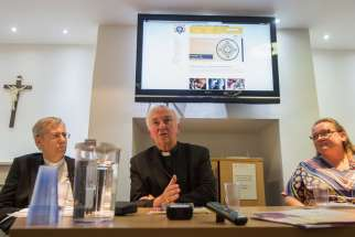 Auxiliary Bishop Nicholas Hudson of Westminster, Cardinal Vincent Nichols of Westminster and Clare Ward, home mission adviser of the Catholic Bishops' Conference of England and Wales, address media July 7 in London about creating evangelization teams for every parish in England and Wales.
