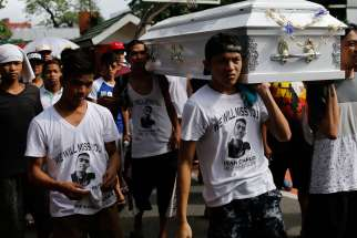 Filipinos carry the coffin of an alleged drug dealer at Manila North Cemetery Aug. 7. Catholic leaders say they are powerless to stop a growing number of extrajudicial killings in the Philippines that have come with Duterte's war on drugs.