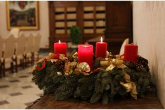 An Advent wreath is pictured in the Apostolic Palace at the Vatican Dec. 15.